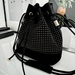 ASOS  black suede bucket bag with gold studs